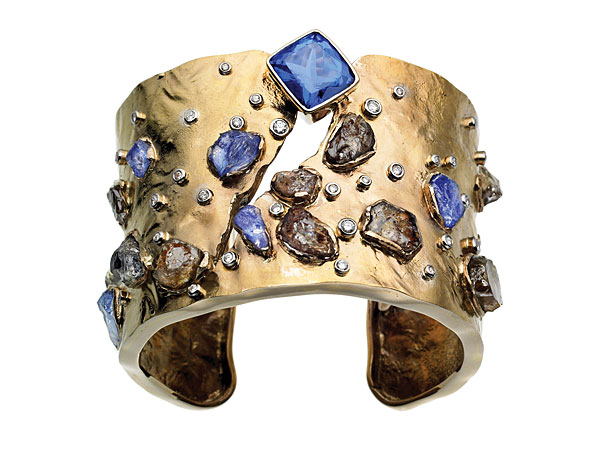 A stunning design from Ginny Dizon, incorporating natural brown and faceted blue tanzanite.