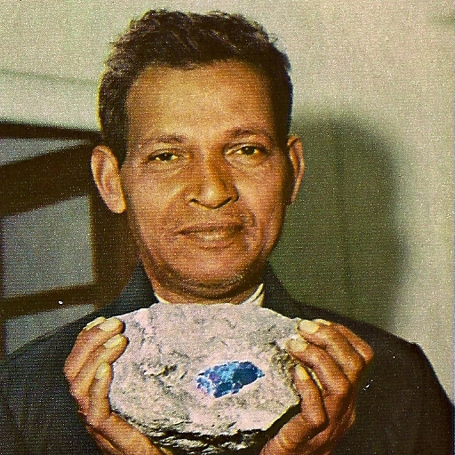 Manuel de Souza with a Tanzanite gemstone