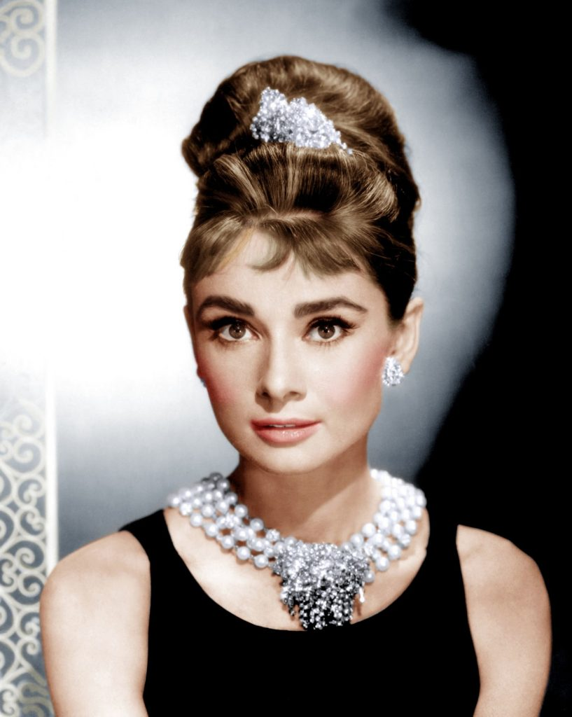 Audrey Hepburn's Holly Golightly in a Givenchy's black dress and Jewelry in Movies: Roger Scemama's pearl necklace